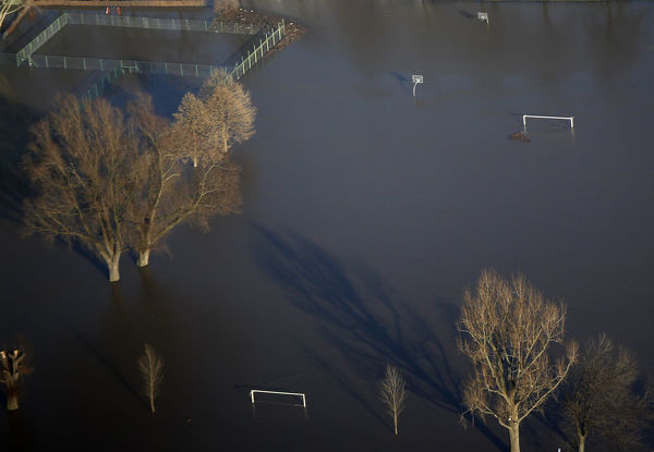 An aerial view shows a submerged soccer field at the flooded riverside of the Rhine