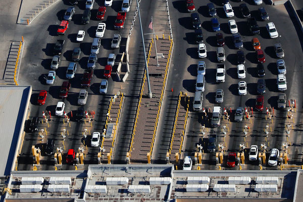 Automobiles pass through the U.S. border and into the United States from Juarez