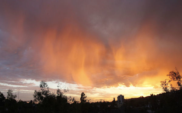 Cloud formations are illuminated by the sun as it sets in Los Angeles