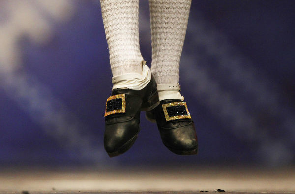 A dancers jumps in a heat during the All Scotland Championships in Irish Dancing at