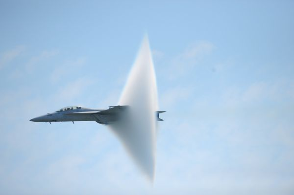 A ring of water vapor is created as pilots Lt. Justin Halligan (L) and Lt. Michael Witt (R) fly their F/A-18F Super Hornet airplane within 200mph of breaking the sound barrier while performing at New York Air Show at Jones Beach in Wantagh, New York