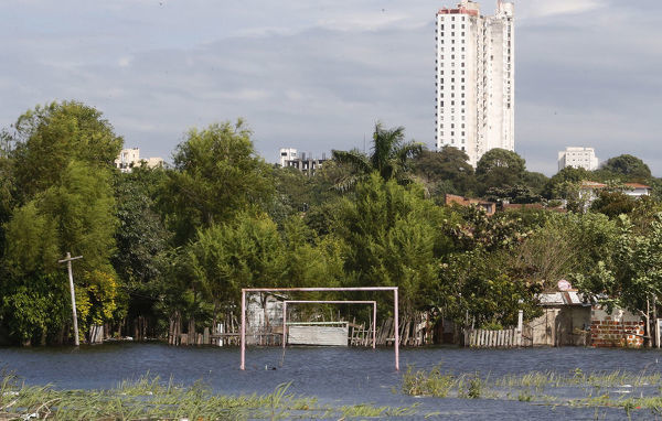 Goalposts stand in a soccer field flooded by the waters of the Paraguay River in Asuncion May 30, 2014