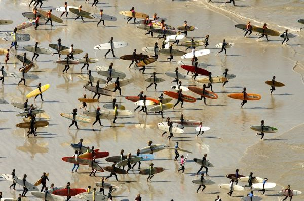 South African surfers take to the water in an attempt to break the Guinness World Record for the highest number of riders on a single wave at Muizenberg in Cape Town, September 2, 2007