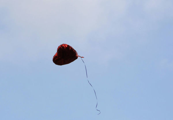 A heart-shaped balloon floats upward during the Seventh Anniversary September 11 Commemoration