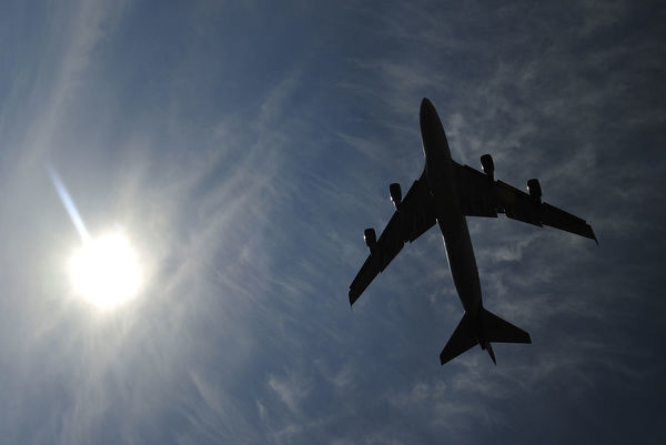 A jumbo jet takes off shortly after midday in London