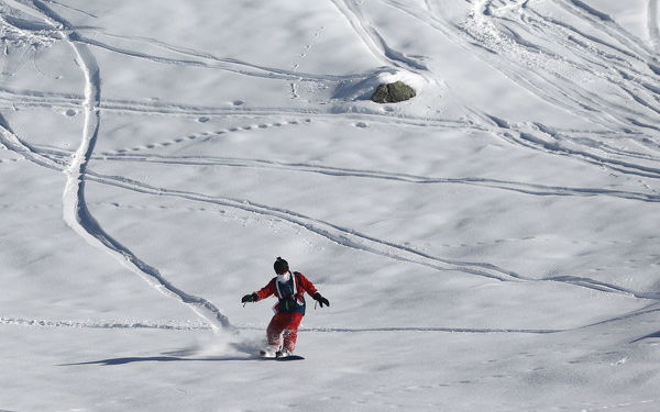 A man, dressed as Santa Claus, takes a curve during a promotional event on the opening weekend in the alpine ski resort of Verbier, Switzerland, December 6, 2015. Skiers dressed as Santa Claus were granted free access to the resort on the day of Saint-Nicolas
