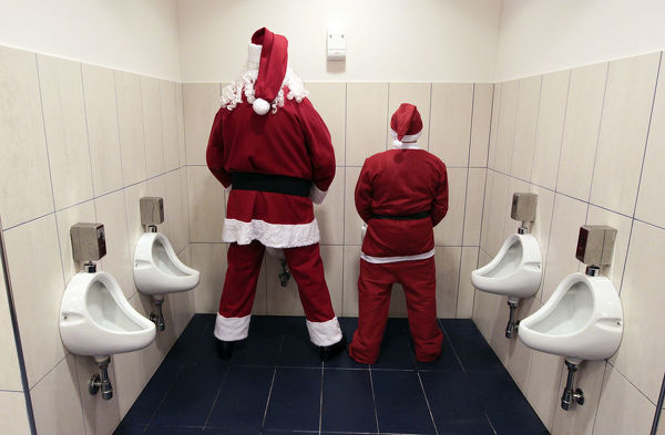 Two men dressed as Santa Claus use a toilet in Citta' Sant'Angelo near Pescara