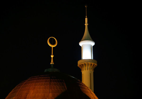 A minaret and a crescent moon on the Abuja central mosque are illuminated as Nigerian